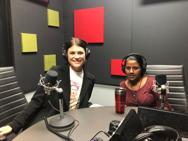 Samantha Moore with Ramya Amuthan sitting in a recording booth