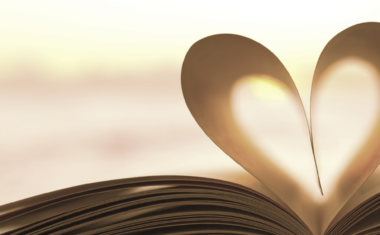 a book laid open with center pages folded to form a shape of a heart