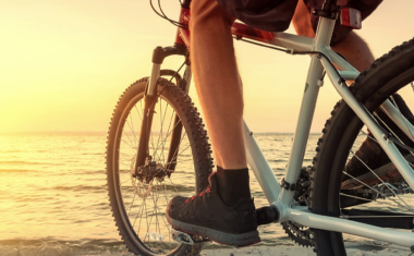 photo of a bike facing the sunset