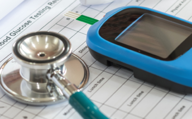 diabetes monitor resting on piece of paper
