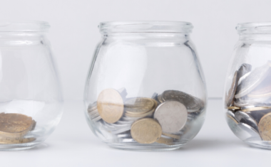 image of three jars filled with coins