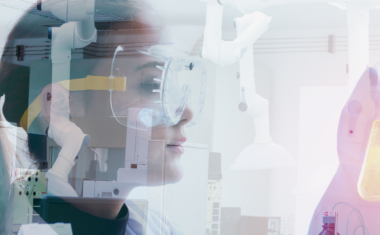 image of female scientist holding lab tools