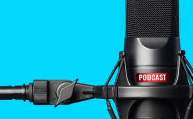 Image of a large microphone with text that reads